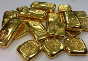 Gold Barren und Münzen